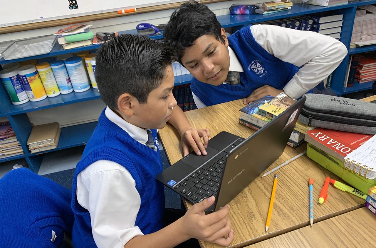 Santa Teresita Students Working on Computer